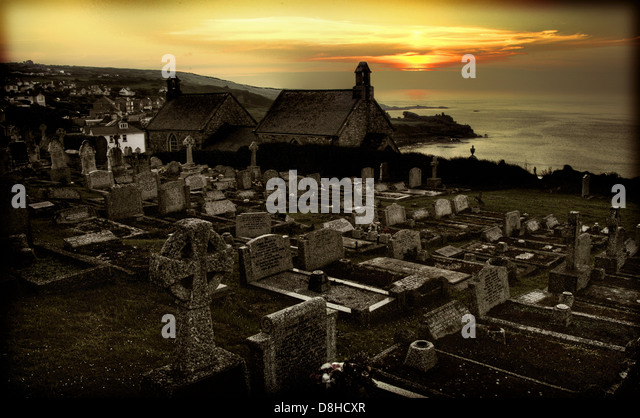 Sunset over Barnoon cemetery & chapel St Ives Southern Cornwall, England, UK West Penwith local authority - Stock Image