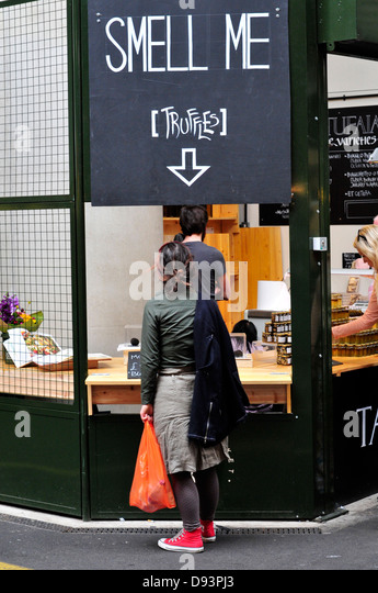 A stall selling cakes in Borough food market, central London, UK - Stock Image
