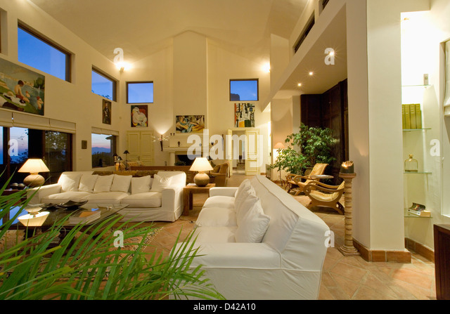 Large Double Height Living Room In Modern Spanish Villa Stock Image