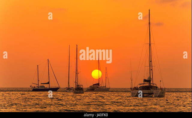 Sunset on Nai Harn Beach Phuket Island Southern Thailand Southeast Asia - Stock Image