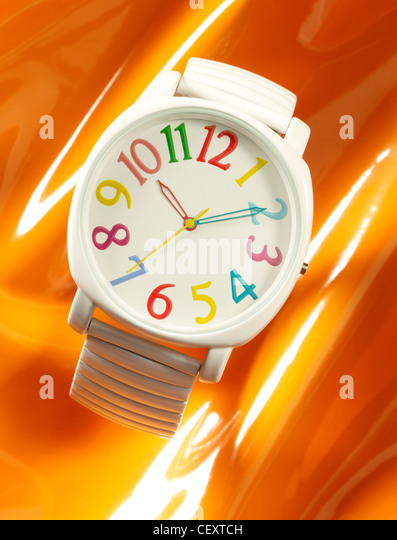 A still life shot of a funky bright watch - Stock Image