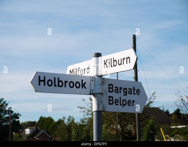 Signpost fo Holbrook and Belper in Derbyshire, United Kingdom. - Stock Image