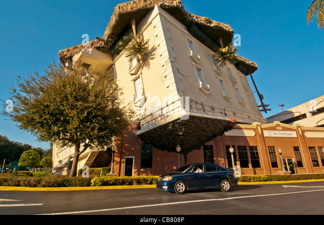 WonderWorks attraction upside-down building with auto for size comparison, Orlando, Florida - Stock Image