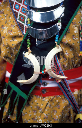 Florida Seminole Indian man tradtional dress bracelets necklace bright colors - Stock Image