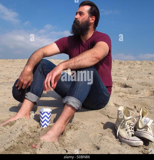 Sitting On Beach - Stock Image