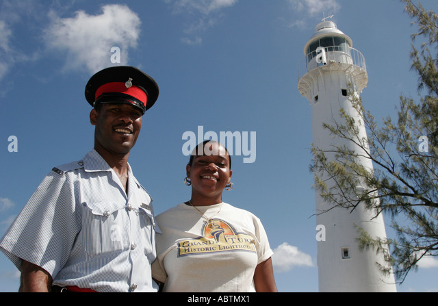 Turks and Caicos Grand Turk Lighthouse built 1852 North East Point Black male policeman female tour guide - Stock Image
