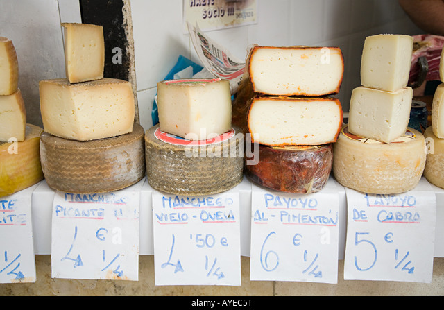 Cheese on a market stall - Stock Image