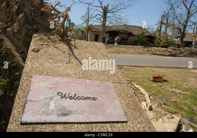 A welcome mat laying on broken porch after tornado hit Tuscaloosa Alabama, May 2011 - Stock Image