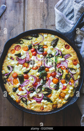 Vegetable and cheese cornbread skillet - Stock Image