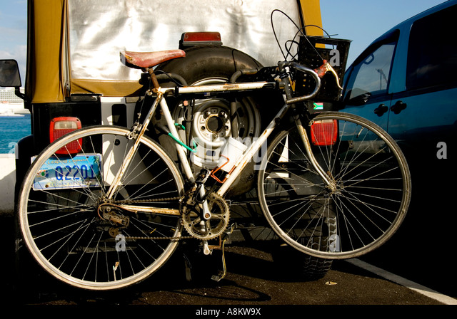 Grand Cayman George Town jeep bicycle cycling - Stock Image