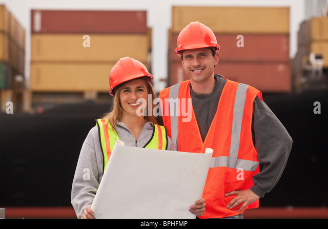 Transportation engineers holding a blueprint - Stock Image