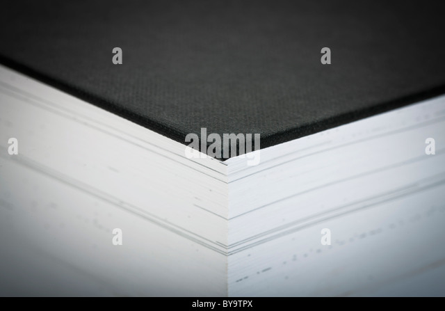 Extreme close-up of a thick book - selective focus - Stock Image