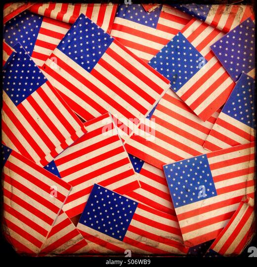 Miniature paper Stars and Stripes,the flag of the United States form a vintage background - Stock Image