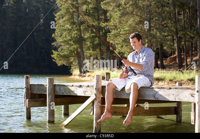Young man fishing - Stock Image
