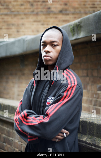 man with hooded top - Stock-Bilder