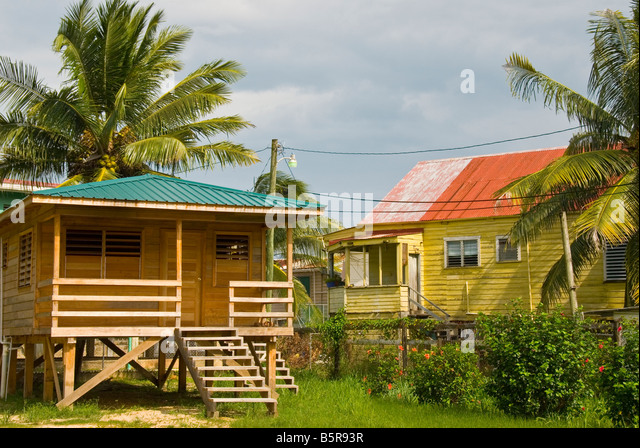 Belize City homes local architecture small wood buildings metal roofs bright colors - Stock Image