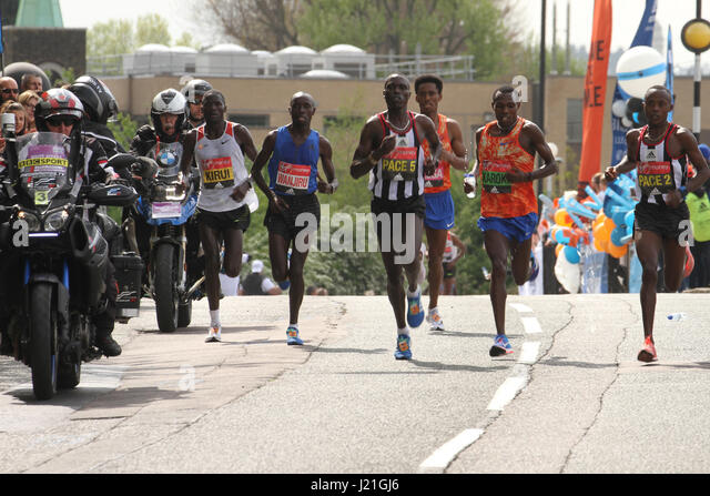 London, UK. 23rd Apr, 2017.  Marathon winner Daniel WANJIRU of Kenya (blue top) flanked by Kirui, Lelisa and Karoki - Stock Image