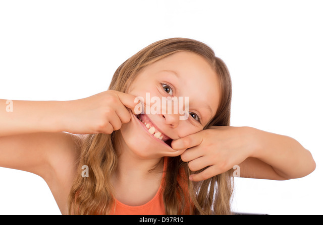Happy girl make a grimace. Isolated on a white background. - Stock Image