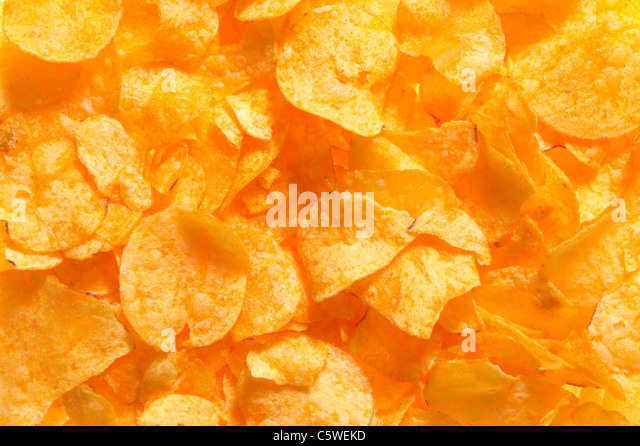 Potato chips, full frame, close-up - Stock Image