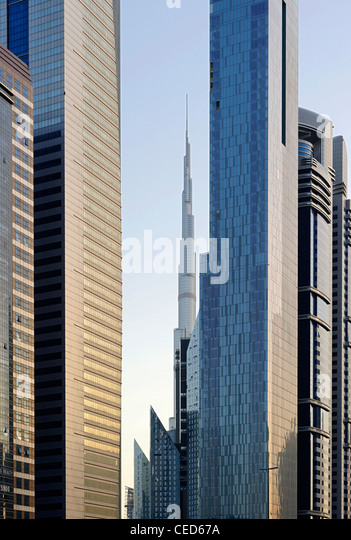 Towers, skyscrapers on Sheikh Zayed Road, in the back the Burj Khalifa, Dubai - Stock Image