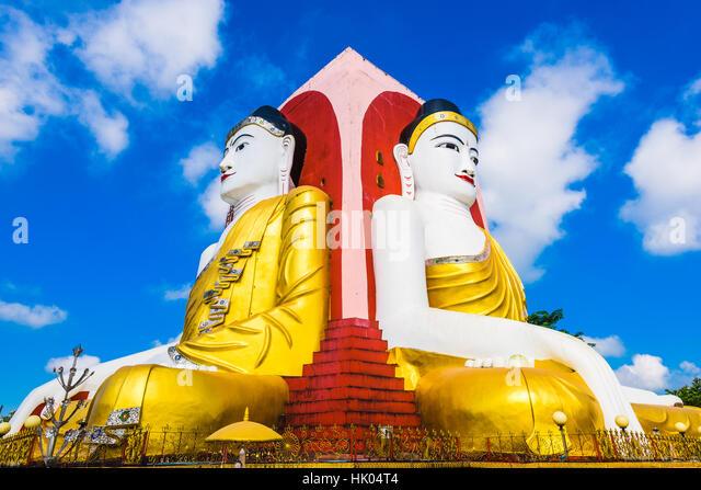 Bago, Myanmar Four Faces of Buddha at Kyaikpun Buddha. - Stock Image
