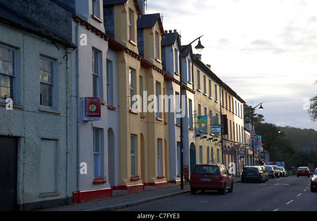 row of houses townhouses and shops on the mall ramelton county donegal republic of ireland - Stock Image