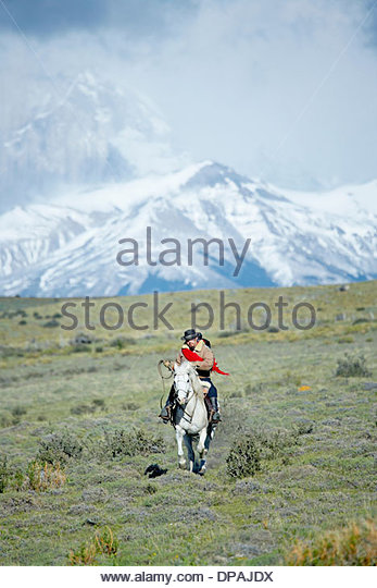 Man riding horse, Patagonia, Chile - Stock Image