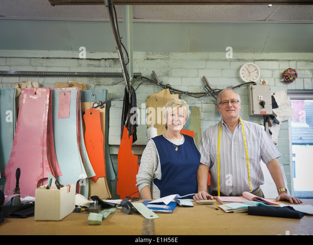 Husband and wife owner of clothing factory, portrait - Stock Image