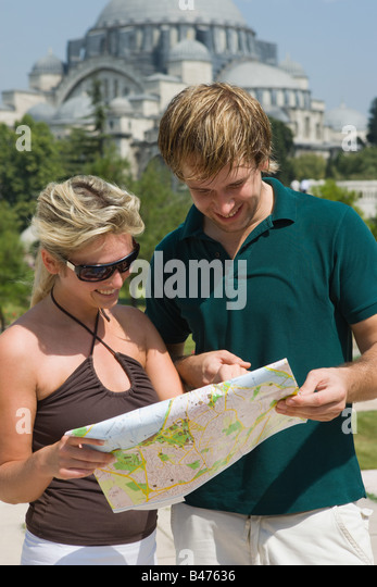 Couple in istanbul with map - Stock Image