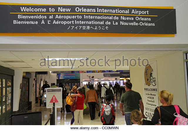 New Orleans Louisiana Louis Armstrong New Orleans International Airport MSY terminal concourse sign welcome multi - Stock Image