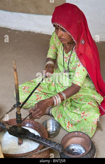 Indian woman making lassi (yogurt).Khuri village.Rajasthan.India - Stock Image