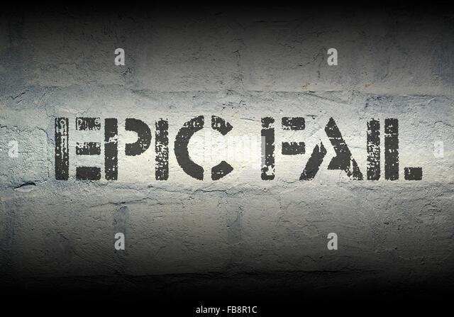 epic fail  stencil print on the grunge white brick wall - Stock Image
