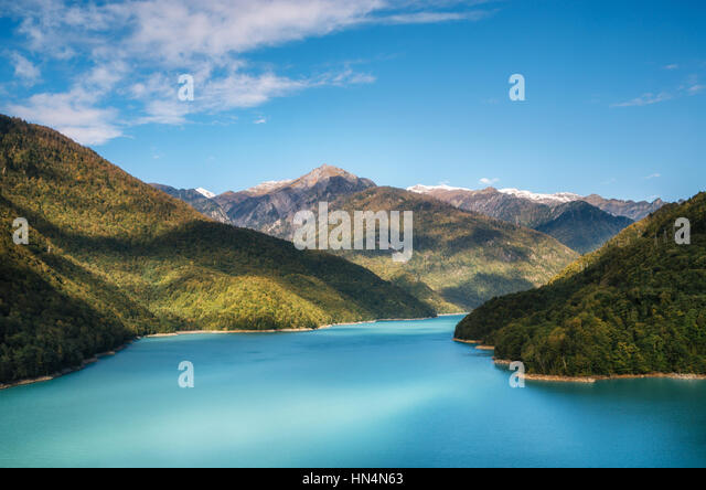 Jvari Reservoir Enguri River with a vibrant turquoise blue water between the mountains, Upper Svaneti, Georgia. - Stock Image