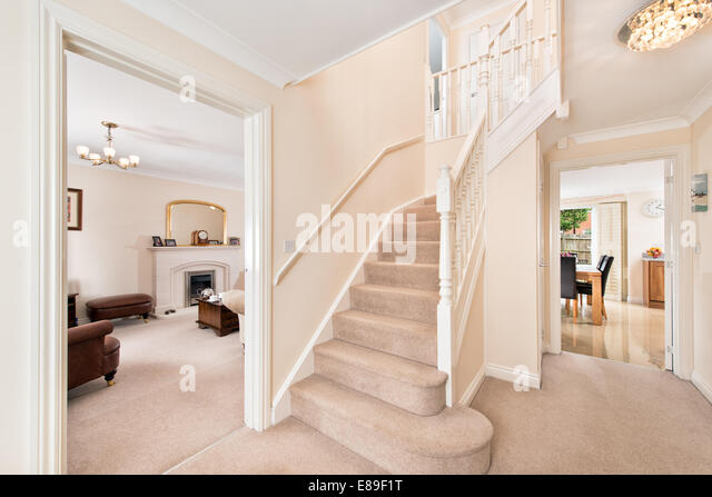 Hallway house stairs stock photos hallway house stairs for Modern entrance hall