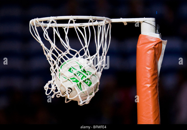 Netball in hoop - Stock Image