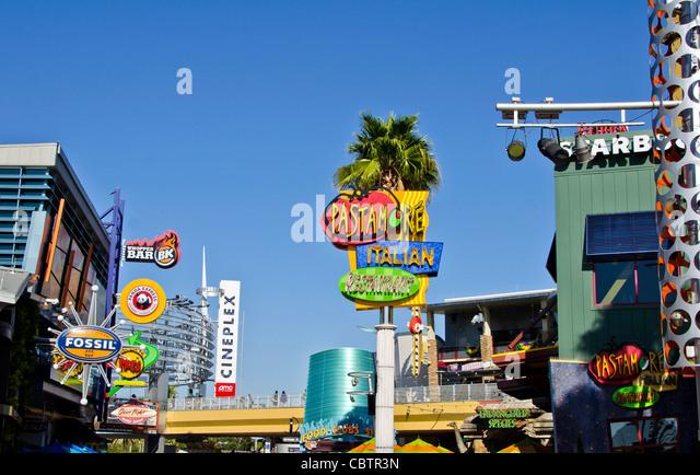 CityWalk signs showing restaurants shops and bars at Universal Orlando Resort Florida - Stock Image