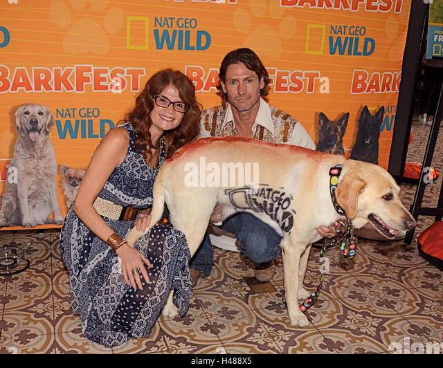 Producer Gena Yates, Mike Johnson and Boomer with the NAT GEO WILD Stencil attends Nat Geo WILD 2nd Annual Barkfest - Stock Image