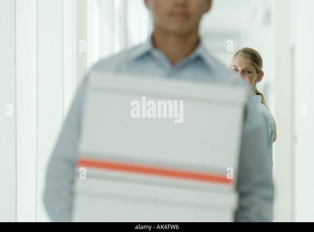 Office workers in corridor - Stock Image