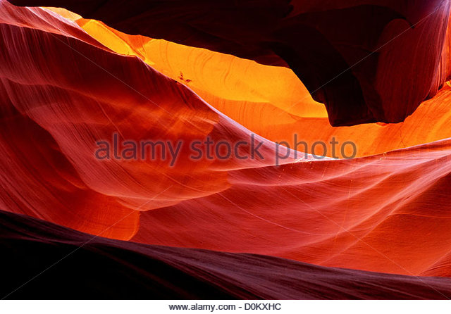Red Sandstone in Antelope Canyon Worn Smooth by Erosion Due to Flowing Water - Stock Image