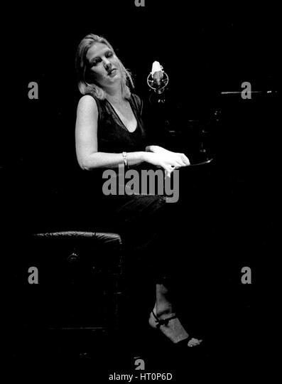 Female Singer Performing At Jazz Club Stock Photos