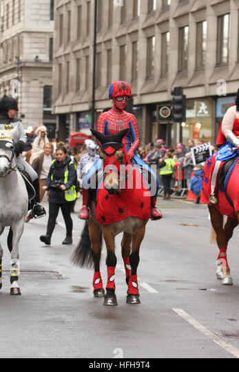 London, UK. 1st January 2017. A performer dresses as spiderman rides a horse  during the New Year's Day Parade - Stock Image