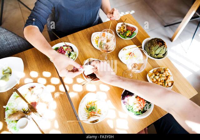 High angle view of couple eating meze at Lebanese restaurant - Stock-Bilder