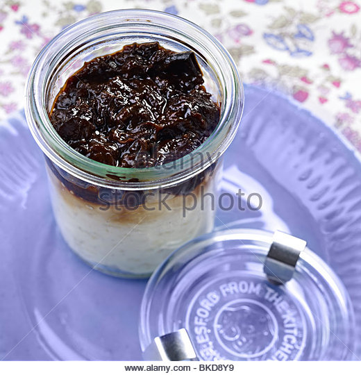 prune topped rice pudding - Stock Image