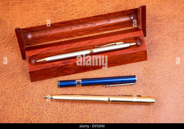 Three pens on a textural - Stock Image