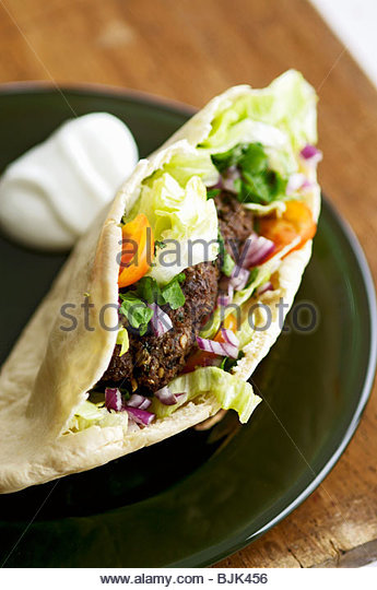 Pita bread filled with grilled lamb (Lebanon) - Stock Image