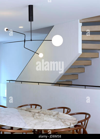 Ground floor looking towards staircase with Michael Anastassiades Mobile Chandelier. Notting Hill House, London, - Stock-Bilder