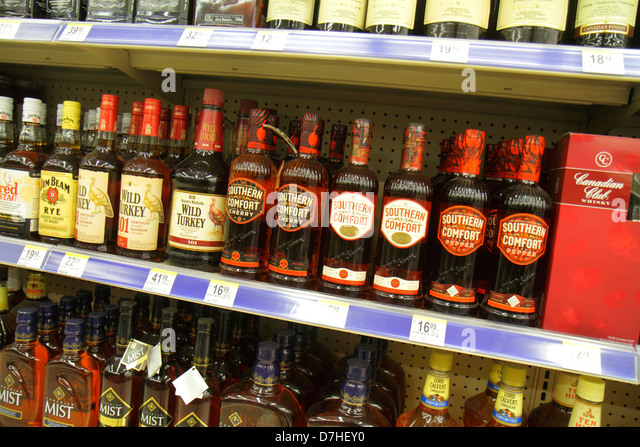 Miami Beach Florida Walgreens liquor store shelves retail display for sale prices bottles alcoholic drinks Southern - Stock Image