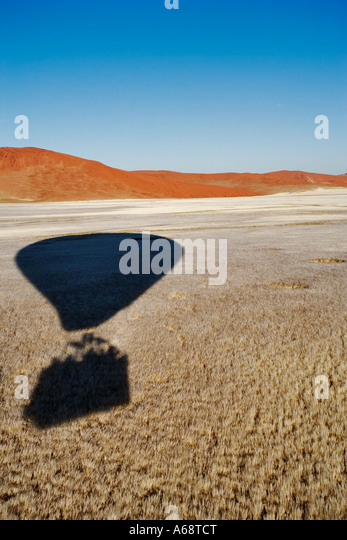 Aerial view of hot air balloon shadow over the Namib desert Property Released Namib Naukluft Park Namibia - Stock Image