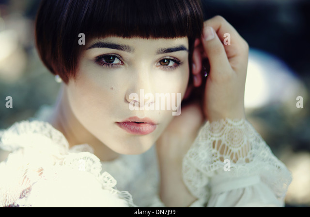 Portrait of a young woman looking at camera - Stock Image