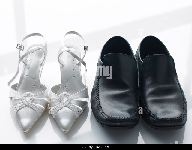 Bride And Groom's Shoes Side By Side - Stock Image